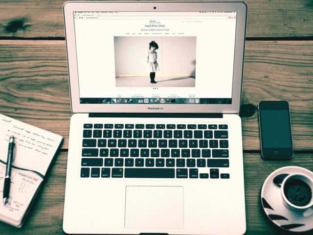 Half Pint Chic Magento website displayed on a Mac Book